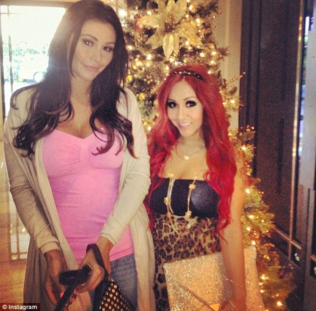New roomie: Snooki and her taller reality costar JWoww snuck in a few poses