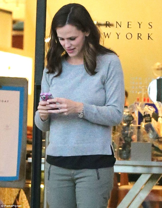 Texting Santa? Jennifer pulled out her phone as she did her holiday shopping