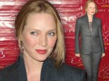 Forty-something and flawless: New mother Uma Thurman displays her age-defying complexion