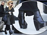 Teetering on the edge: Strained looking Rachel Zoe balances on gravity-defying wedges...a week after her fashion line was dropped by another major department store