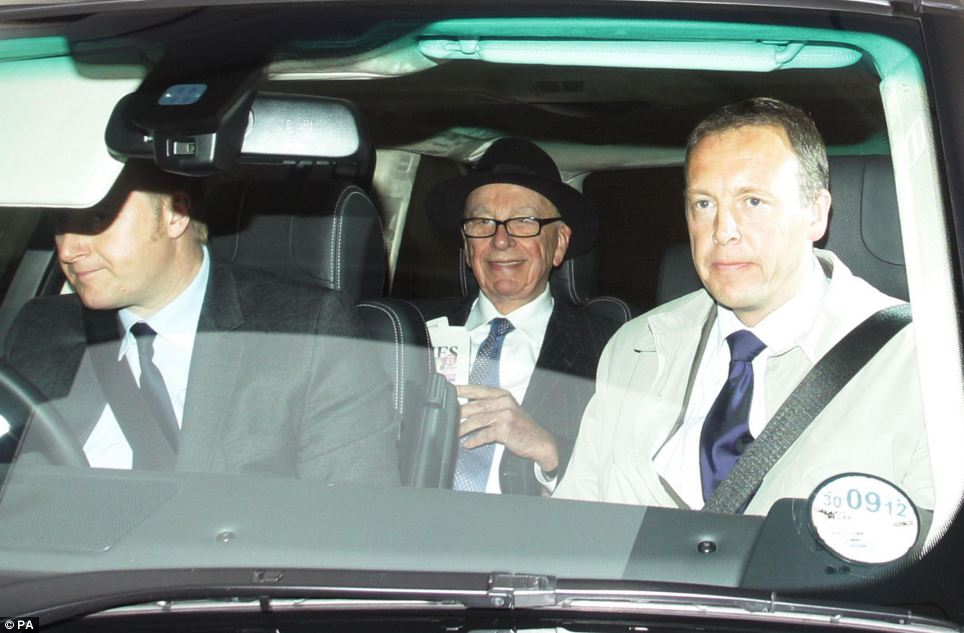 Under fire: Rupert Murdoch, Chairman and CEO of News Corporation, leaving his home in central as his son James appeared at the Leveson inquiry