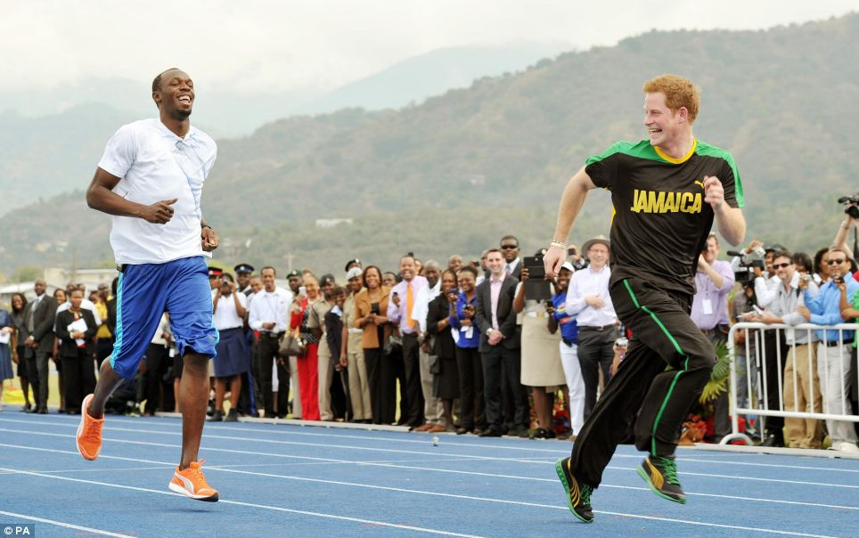 Catch me if you can: Prince Harry jokingly sprints with Olympic sprint champion Usain Bolt while visiting Jamaica