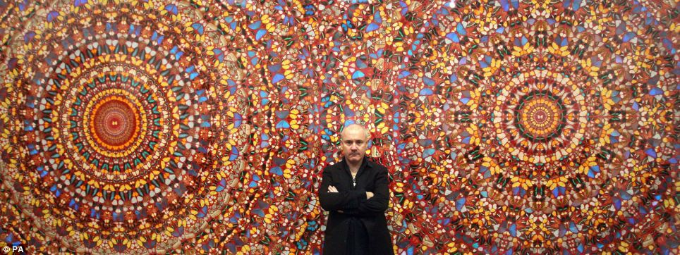 On display: Artist Damien Hirst with his work I Am Become Death, Shatterer of Worlds 2006 during the opening of his solo exhibition at the Tate Modern in central London