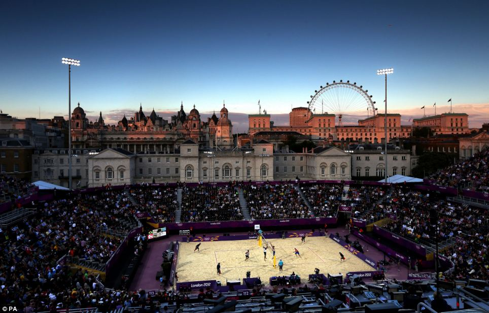 London sky: Crowds enjoy a mens beach volleyball match at Horse Guards Parade, London
