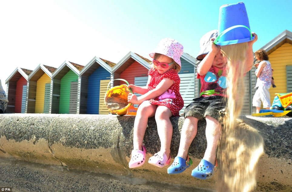 Enjoying the summer: Cerys Scott, three, left, and Corey Thompson, three, enjoy the sun at Blyth beach during the spring heatwave