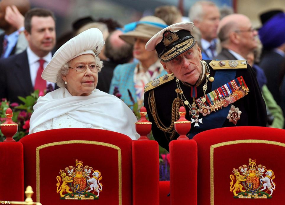 Intrigue:  Queen Elizabeth II and the Duke of Edinburgh onboard the Spirit of Chartwell during the Diamond Jubilee Pageant