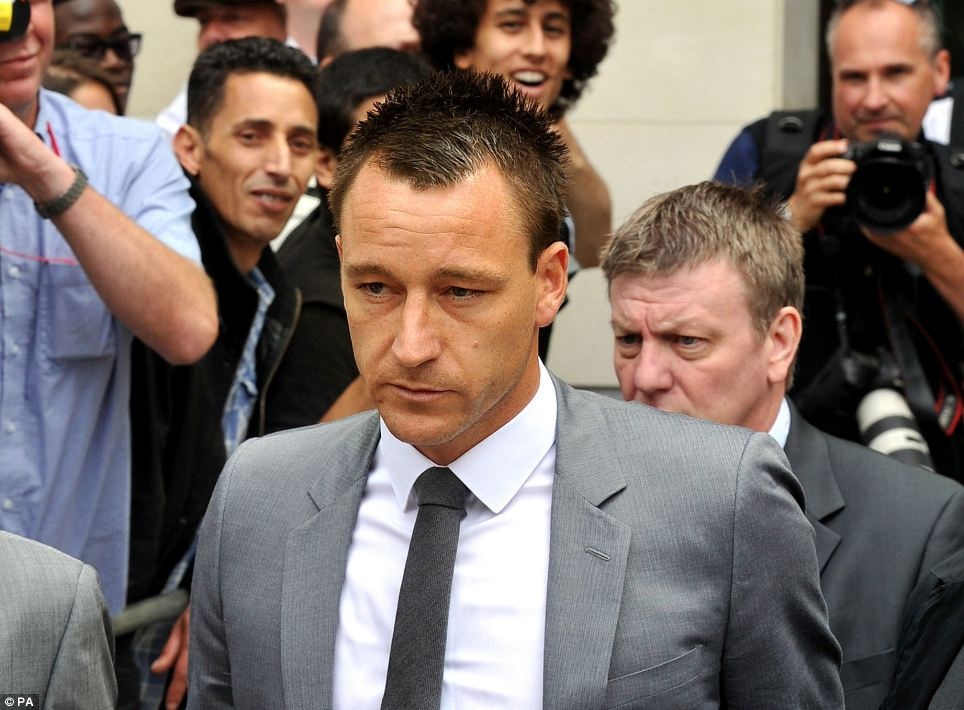 Chelsea captain John Terry leaves Westminster Magistrates' Court, London, after he was cleared of hurling a racist insult at Anton Ferdinand