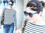 Stress relief: Skinny Selma Blair sneaks a smoke as she shops by herself in Los Angeles