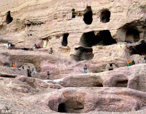 Hazara ethnic group standing outside their caves in Bamiyan