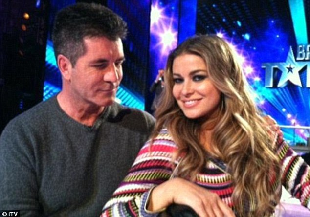 'She's adorable': Simon Cowell has confirmed that he is dating Carmen Electra, seen here with him on Britain's Got Talent