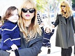 The happy toddler entertained his doting mother, and onlookers, as they enjoyed a shopping trip to the fashionable Kitson store in West Hollywood.