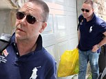The film star was laden with a bag of gifts as he arrived at the home where his children live with their mother in Sydney on Wednesday.