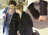 Hand-in-hand jetsetters: Renée Zellweger and new beau look smitten as they fly out of New York for Christmas