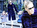 Sarah Jessica Parker walks with her two twin daughters, Marion and Tabitha, dressed in purple