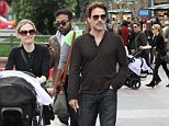 Anna Paquin shows off her incredible post-baby body as she and husband Stephen Moyer take twins Christmas shopping