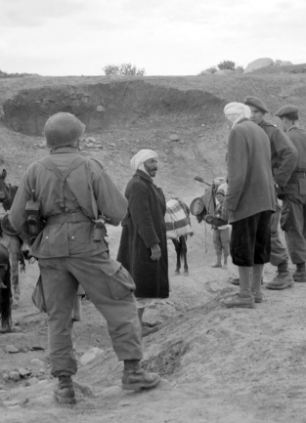 French paratroopers spot check Algerian peasants ten days after a series of attacks that marked the start of the Algerian independence war