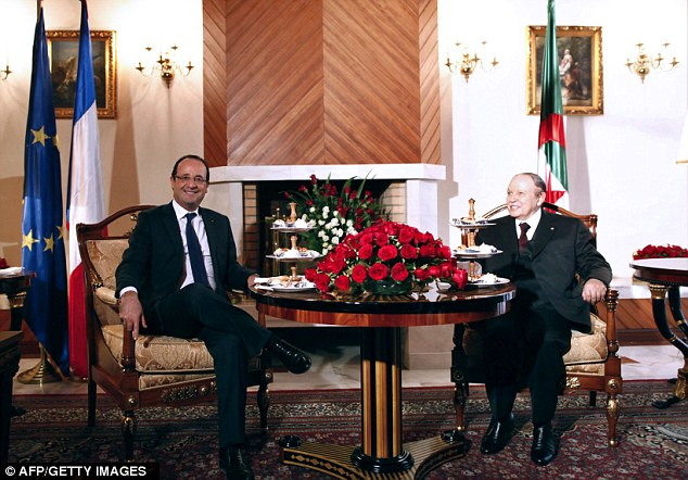 Increased trade: President Francois Hollande, left, was invited to Algeria by President Abdelaziz Bouteflika, right, for the landmark visit amid hopes of a new phase in relations