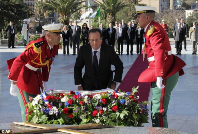 Respect: President Francois Hollande laid a wreath of flowers at the Algerian war memorial