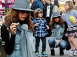'What a holiday drag': Brooke Burke-Charvet puts on brave face after cancer surgery to visit Santa Claus with her kids