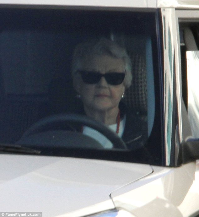 Shady lady: Angela wore some black wayfarer sunglasses to keep the Californian sun out of her eyes whilst she negotiated the roads