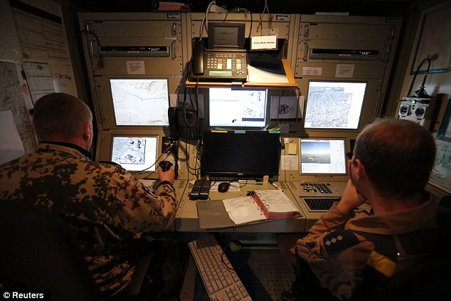 Pilot operators control an unmanned aerial vehicle (UAV) on a mission; drone operators typically work out of small bunkers such as these
