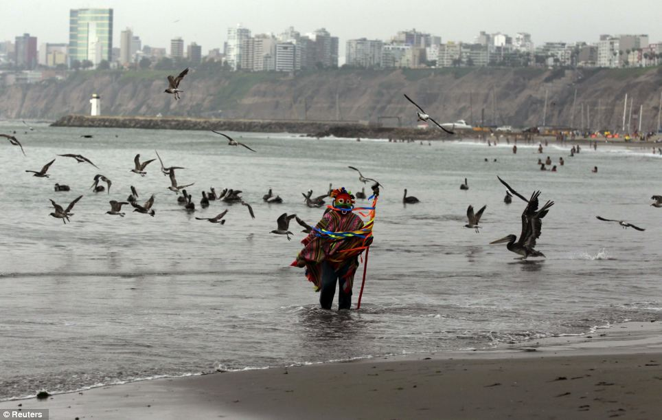 Effort: A Peruvian shaman performs a ritual at the edge of the sea