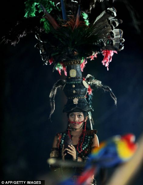 A member of a folkloric group performs during celebrations marking the end of the Mayan age, December 20, 2012 at the Tikal archaeological site, Peten departament, 560 kms north of Guatemala City
