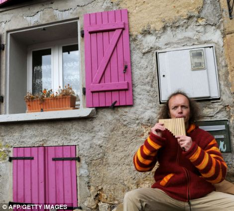 Sylvain Durif, presenting himself as the messanger of God and Christ, plays panpipes
