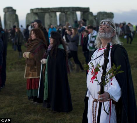 Druid leader Arthur Uther Pendragon, right, looks up