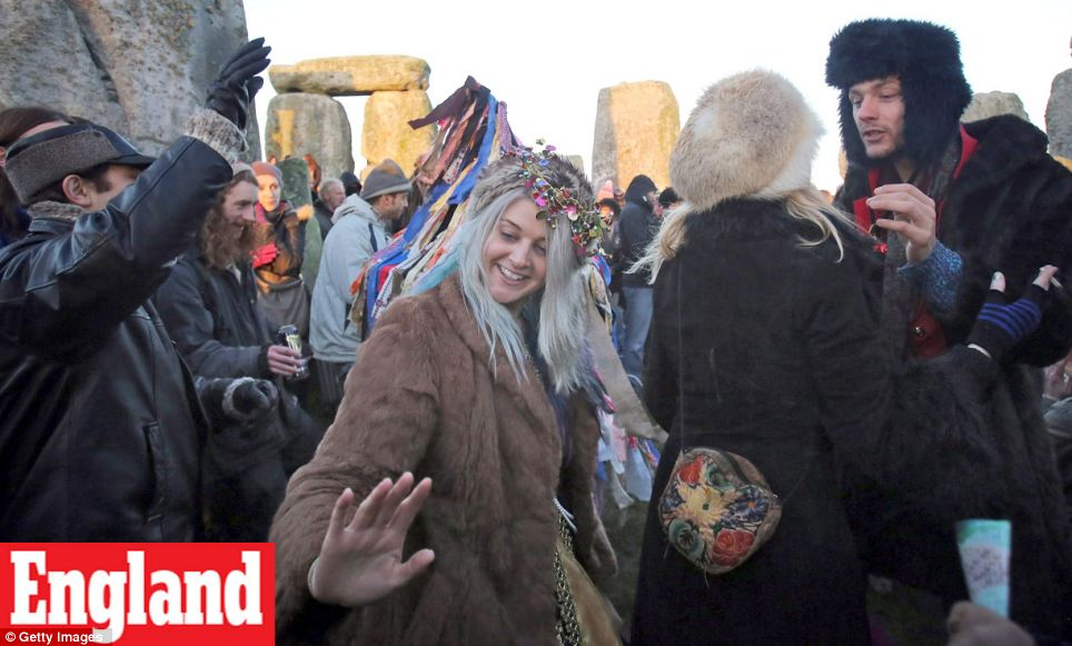 """Rejoice: More than 5,000 people have gathered to mark the winter solstice at Stonehenge as the date coincides with the end of the 5,125-year """"long count"""" cycle of the Mayan calendar"""