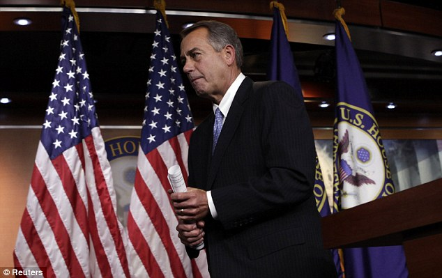 US House Speaker John Boehner leaving his news conference on the 'fiscal cliff' on Capital Hill, Washington, yesterday