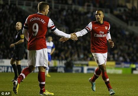 Impressive: Theo Walcott (right) shone in Arsenal's 5-2 win over Reading