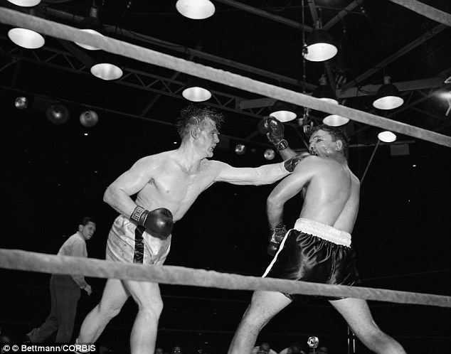 Defiant: LaMotta (right) was known for his aggressive boxing style where he stalked opponents closely around the ring, taking many blows on the chin himself