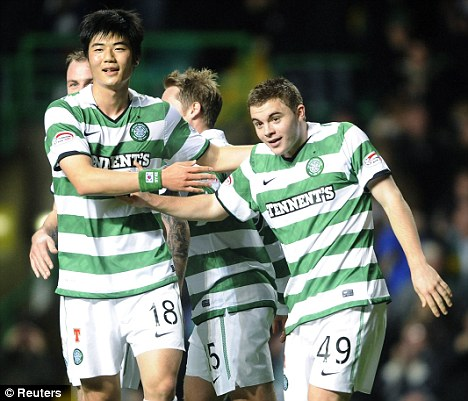 Going well: Celtic are top of the SPL