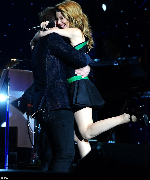 A hug for success: Kylie and Jason celebrate after their performance