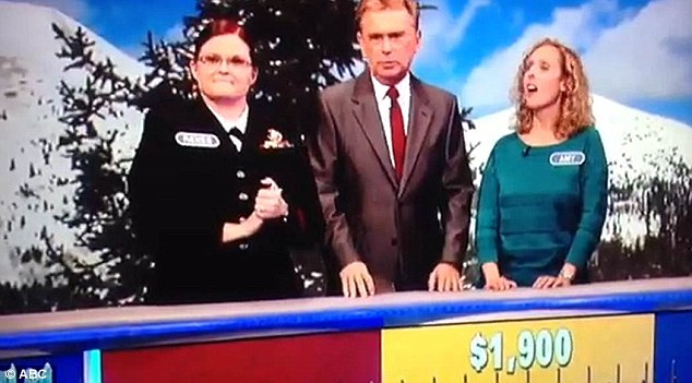 Gee, that's strict! Sajak, center, informed Durette, left, and Vincenti, right, that the former's answer was rejected because she pronounced it in the vernacular