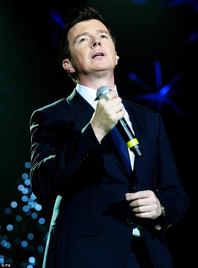 Suited and booted: Crooner Rick Astley got the crowd going as he performed some of his hits