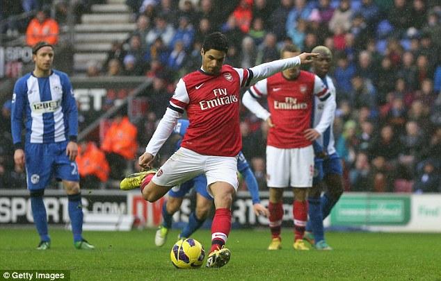 Spot on: Arteta makes no mistake with his penalty