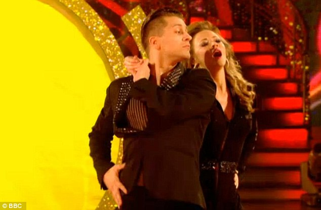 Outfit number one: Kimberley first appeared wearing a slinky black catsuit