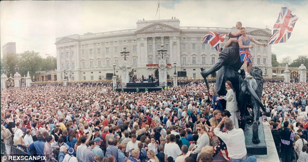 Joyous: Jubilant crowds gather outside Buckingham Palace to celebrate the 50th anniversary of Victory in Europe Day in 1995