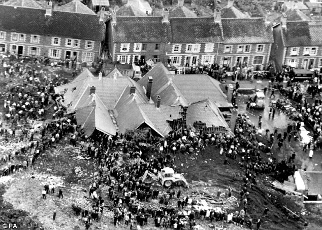 Tragedy: The scene in October 1966 where 116 children and 28 adults died when a slag heap collapsed and enghulfed Pantglas Junior School in Aberfan, Wales, which the Queen referred to in her message that year