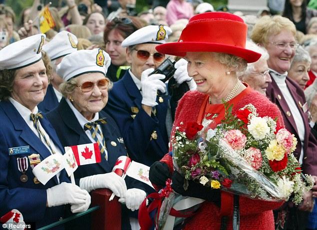 Popular: Queen Elizabeth II carries a bouquet of flowers during her Golden Jubilee Tour of Canada in 2002