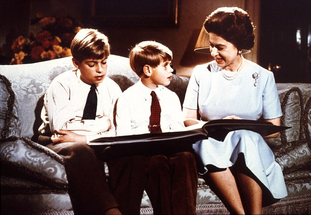 Family values: Queen Elizabeth looks through a photo album with Prince Andrew (left) and Prince Edward (centre) for her Christmas message in 1971