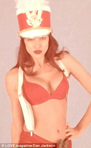 Naughty or nice: Irina Shayk (L) and Lily Aldridge both raise the temperatures in their videos for LOVE magazine Christmas advent calendar
