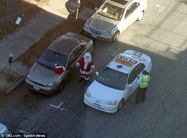 The famous Father Christmas charm seemed to fall on deaf ears, and the parking warden slapped him with a fine. Looks like someone might be getting a lump of coal in their stocking this year....