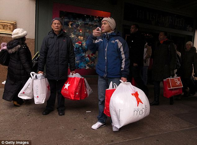 Looking for deals: Retailers dealt with concerned shoppers who did not buy as much this year leading up to Christmas (pictured) so now are hoping to lure them in again with new deals on the day after Christmas
