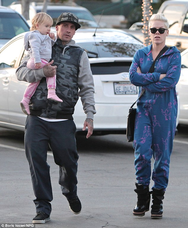 Rocking her onesie! Singer Pink and Carey Hart take their daughter Willow to the park on a chilly day in Malibu