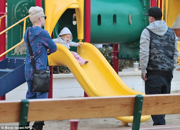 Playtime! The indulgent parents watch as Willow tries out the slide
