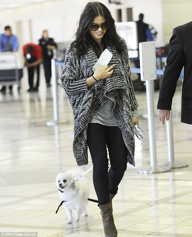 Smiles all round: Jenna looked radiant as she made her way through LAX airport