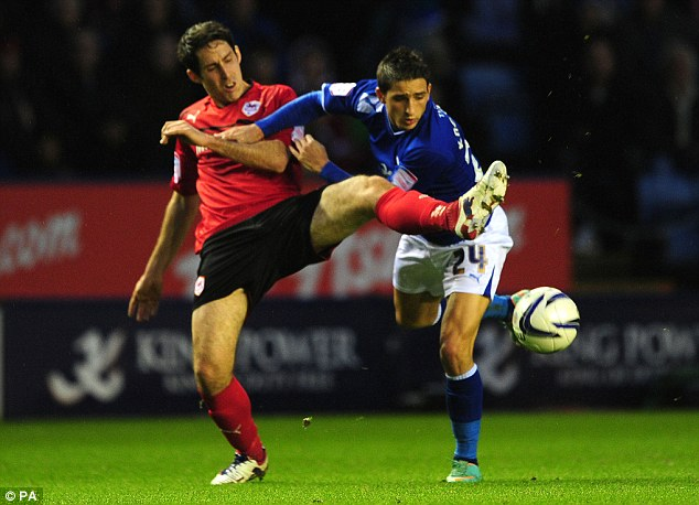 Going up: Leicester City's Anthony Knockaert (right) and Cardiff City's Peter Whittingham